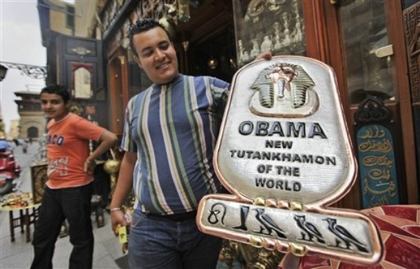 As Egypt prepares for the arrival of President Obama this week, a Cairo vendor displays a handmade copper plaque reading  'Obama, New Tutankhamun of the World.'